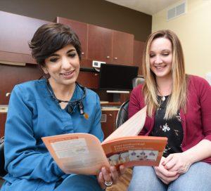 Dr. Govani educating a patient
