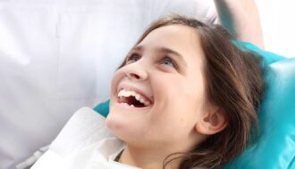 Child dental patient smiling.